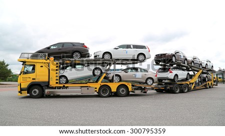TURKU, FINLAND - JULY 12, 2015: Volvo FM car carrier hauls new cars. A scrapping scheme for old vehicles will be carried out in Finland between 1 July and 31 December 2015. - stock photo