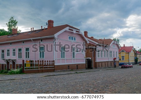 TURKU, FINLAND - JUNE 23, 2017: View of old wooden houses in Port Arthur district, with locals and visitors, in Turku, Finland