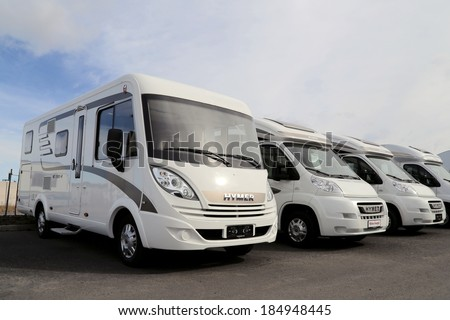 TURKU, FINLAND - MARCH 30, 2014: Hymer motorhomes parked in a row. Starting January 2014, Euro 5b+ emission standards involve RV??s and vans. - stock photo