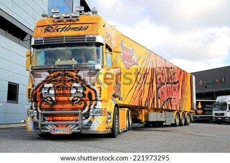 TURKU, FINLAND - OCTOBER 4, 2014: Scania R620 Show Truck Tiger of Kuljetus Ristimaa Oy at a warehouse. Ristimaa a well known Finnish truck tuning team. - stock photo