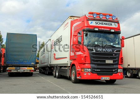 TURKU, FINLAND - SEPTEMBER 15: Scania R500 V8 truck with DB Schenker trailer on September 15, 2013 in Turku, Finland. DB Schenker land transport is the leading ground forwarding network in Europe.