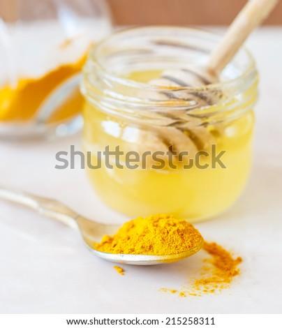 Turmeric and honey - stock photo