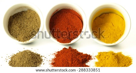 Turmeric, cumin and hot pepper on isolated background - stock photo