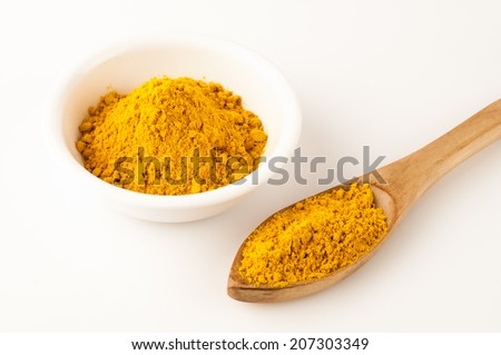 turmeric cup wooden spoon isolated on white