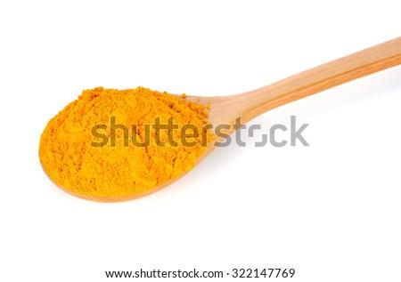 Turmeric (Curcuma) powder on wooden spoon isolated on white background. - stock photo