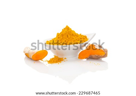 Turmeric fresh and dry ground in white bowl isolated on white background. Asian culinary spice. Ayurvedic traditional medicine. - stock photo