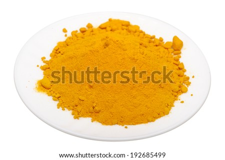 Turmeric on a white plate, isolated on a white background - stock photo