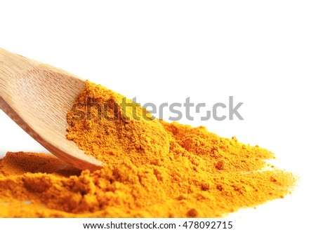 Turmeric powder and wooden spoon on white background