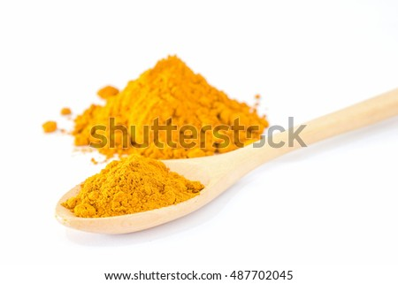 Turmeric powder in wood spoon on white background