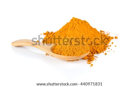 Turmeric powder on a wooden spoon isolated on white background. - stock photo