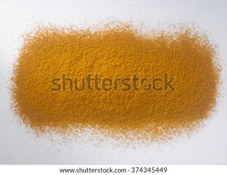 turmeric powder on the white background - stock photo