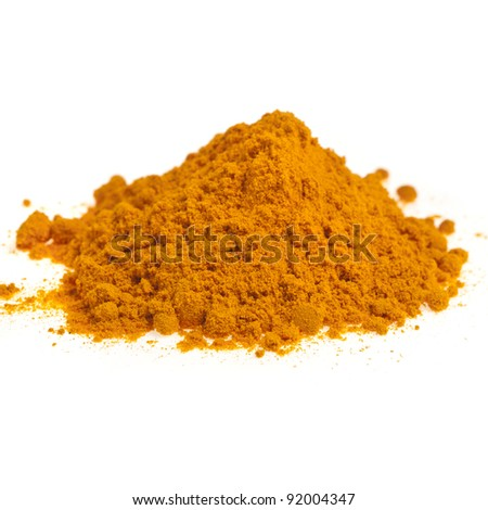 Turmeric powder spice pile isolated on white background