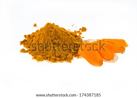 turmeric powder with fresh turmeric root on white background - stock photo