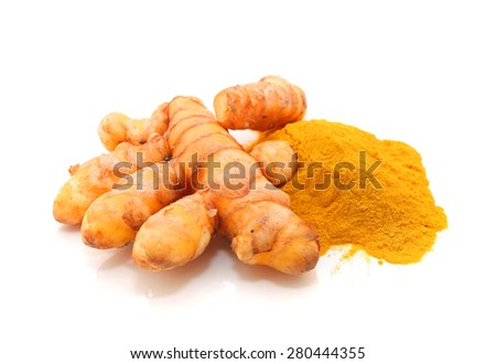 turmeric powder with turmeric root isolated on white - stock photo