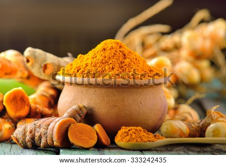 turmeric roots on wooden table - stock photo