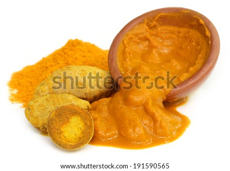 Turmeric with powder and paste on a brown bowl - stock photo