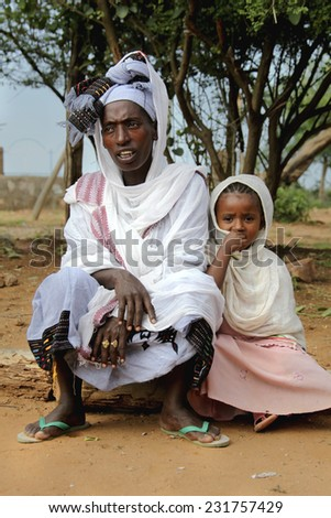 TURMI, ETHIOPIA - NOVEMBER 22, 2011: Portrait of the African woman with the daughter in national Ethiopian clothes. November 22, 2011 in Turmi, Ethiopia. - stock photo