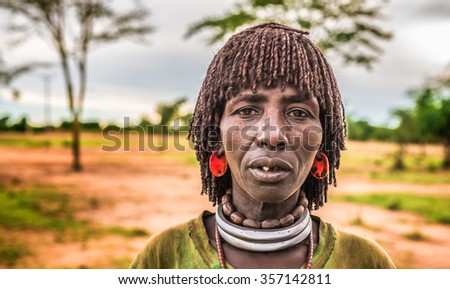 TURMI, OMO VALLEY, ETHIOPIA - MAY 5, 2015: Woman from the Hamar tribe at a local market in south Ethiopia.