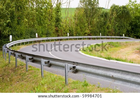 Turn in the road with guard rail - stock photo