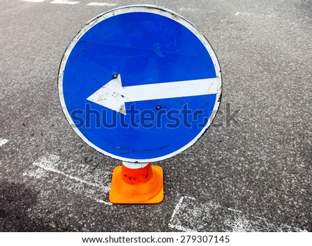 Turn left sign on the traffic cone. Close up. - stock photo