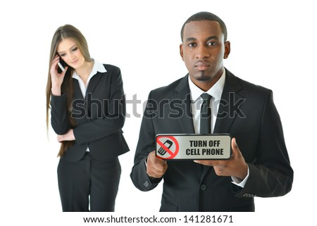 Turn off cell phone with serious expression - stock photo