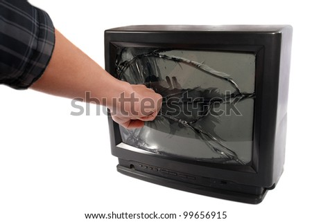 Turn off your TV. Kill it.man's hand punching TV screen - stock photo