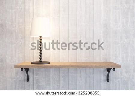 turn on table lamp on the shelf - stock photo