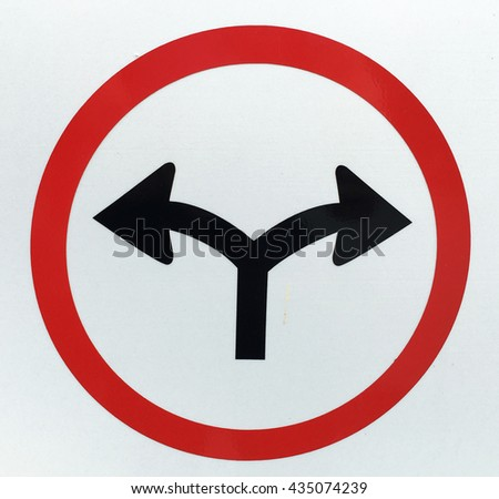 Turn right or Turn left traffic sign - stock photo