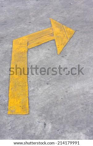 Turn Right, Yellow arrow sign on street.  - stock photo