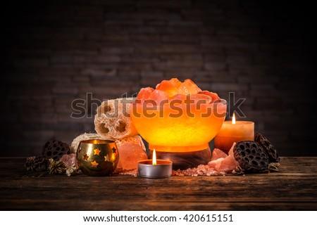 Turned on himalayan crystal natural salt bowl lamp - stock photo