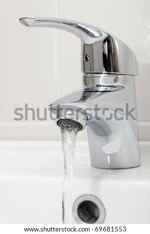 turned on metal tap - stock photo