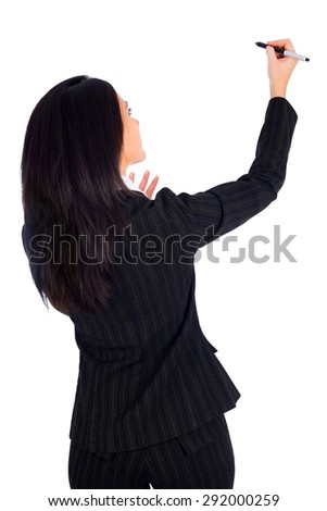 Turned woman with her back teacher writing on wall with pen and explaining. - stock photo