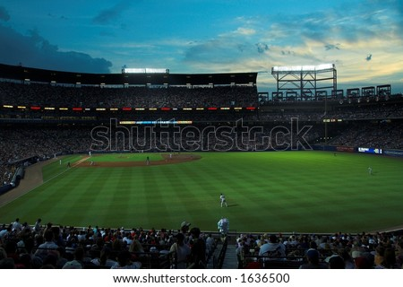 Turner Field, home of the Atlanta Braves, during a night game with capacity crowd; set against a brilliant blue sky - stock photo