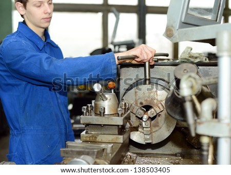 Turner is working on the machine.metal processing.worker works on a lathe.Turner running on the machine. Turning work. metal processing.