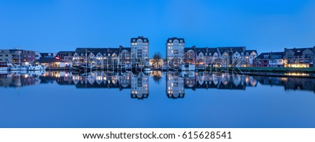 TURNHOUT-APRIL 3, 2017. Twilight view on luxury apartments at the Nieuwe Kaai, with a yacht harbor on Kempisch Canal. The area is developed for wealthy seniors who live in care houses or apartments.