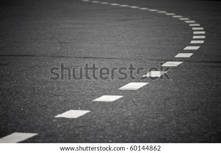 Turning asphalt road with marking lines. Close up photo - stock photo