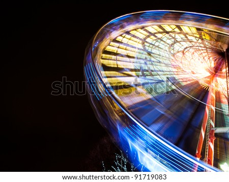 Turning Ferris wheel on a New Year market - stock photo