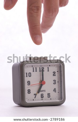 turning off alarm on the alarm clock by finger
