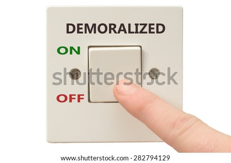 Turning off Demoralized with finger on electrical switch - stock photo