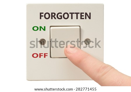 Turning off Forgotten with finger on electrical switch - stock photo
