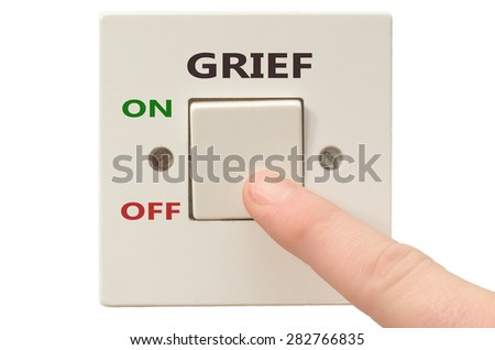 Turning off Grief with finger on electrical switch - stock photo