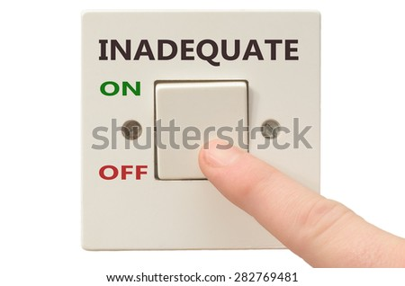 Turning off Inadequate with finger on electrical switch - stock photo