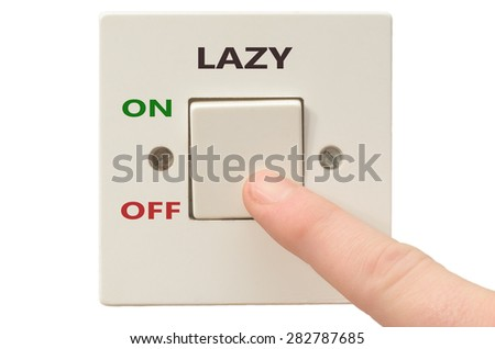 Turning off Lazy with finger on electrical switch - stock photo