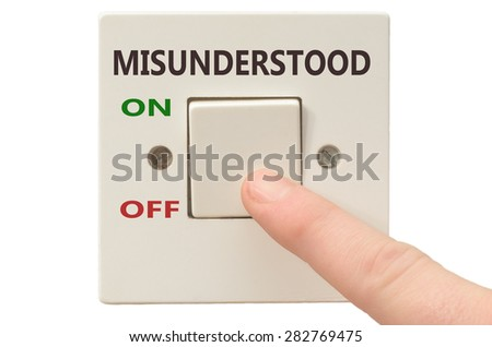 Turning off Misunderstood with finger on electrical switch - stock photo