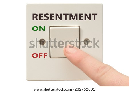 Turning off Resentment with finger on electrical switch - stock photo