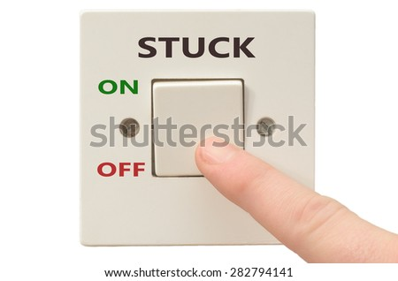 Turning off Stuck with finger on electrical switch - stock photo
