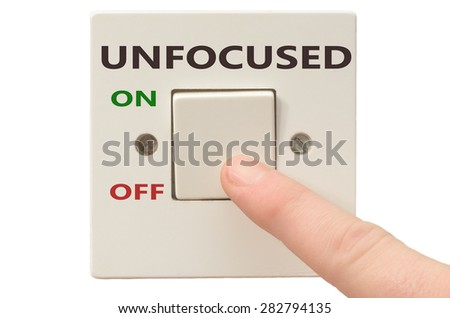 Turning off Unfocused with finger on electrical switch - stock photo