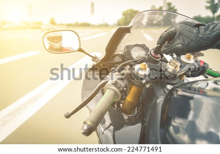 turning on the engine, biker put the ignition key in the hole. ready to ride - stock photo