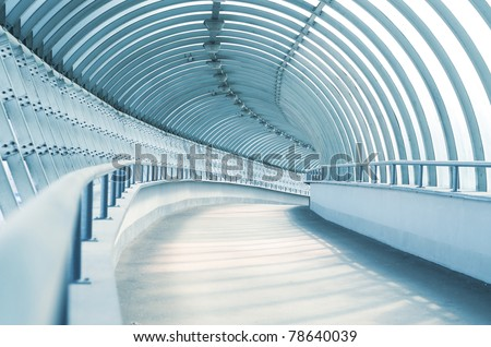 Turning road of a long corridor - stock photo