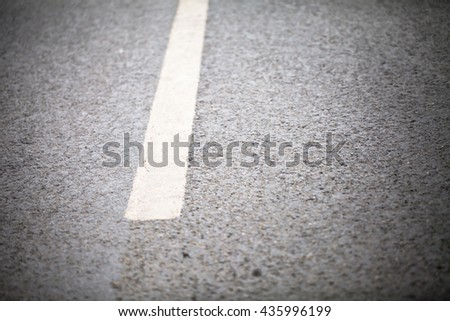 Turning road with marking lines and tire tracks. Close up photo with selective focus - stock photo